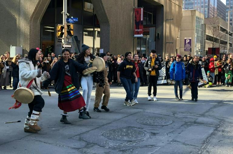 Protesters dance through the streets of Ottawa, Canada on February 24, 2020 in support of a small group fighting construction of a natural gas pipeline on indigenous lands in British Columbia