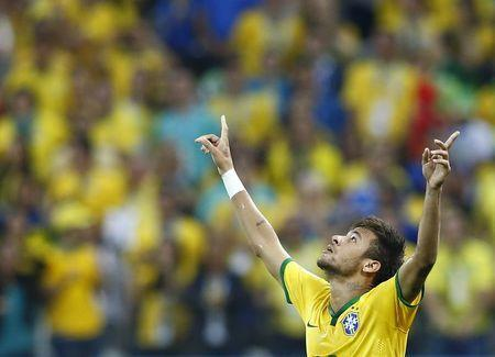 Brazil's Neymar celebrates a goal during the 2014 World Cup opening match between Brazil and Croatia at the Corinthians arena in Sao Paulo June 12, 2014. REUTERS/Murad Sezer
