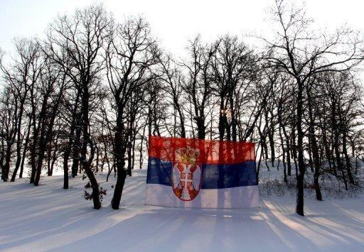 A Serbian national flag is displayed among trees on a snow-covered field in Leposavic, northern Kosovo. Serbs in north Kosovo rejected ethnic Albanian rule Wednesday in a controversial referendum seen as a slap in the face to efforts by Serbia and the EU to resolve differences over the territory