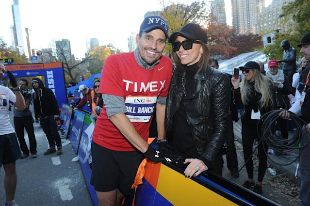 IMAGE DISTRIBUTED FOR TIMEX - Entrepreneur and TV personality Bill Rancic greets his wife, Giuliana Rancic, after finishing the ING New York City Marathon on Sunday, November 3, 2013, in New York's Central Park. Rancic, who was the very last person to start the race, finished with an unofficial time of 4:57. Timex will be donating $30,000 to Fab-U-Wish, a charity founded by his wife Giuliana Rancic that supports women affected by breast and ovarian cancer. (Photo by Diane Bondareff/Invision for Timex/AP Images)