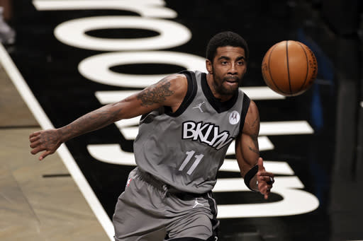Brooklyn Nets guard Kyrie Irving chases down the ball during the second half of an NBA basketball game against the Miami Heat, Monday, Jan. 25, 2021, in New York. (AP Photo/Adam Hunger)