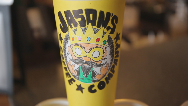 This barista draws charming caricatures of customers on their coffee cups