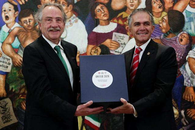 Decio de Maria Serrano, president of the Mexican Football Federation, and Mexico City Mayor Miguel Angel Mancera pose for a photo during the announcement of a joint bid by Mexico, United States and Canada for the FIFA World Cup 2026, in Mexico City, Mexico January 19, 2018. REUTERS/Daniel Becerril