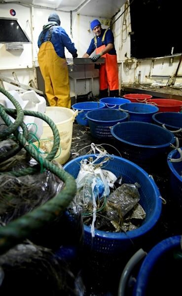 Fishermen say they get so much plastic in their nets that it stops them being able to catch fish (AFP Photo/Filippo MONTEFORTE)
