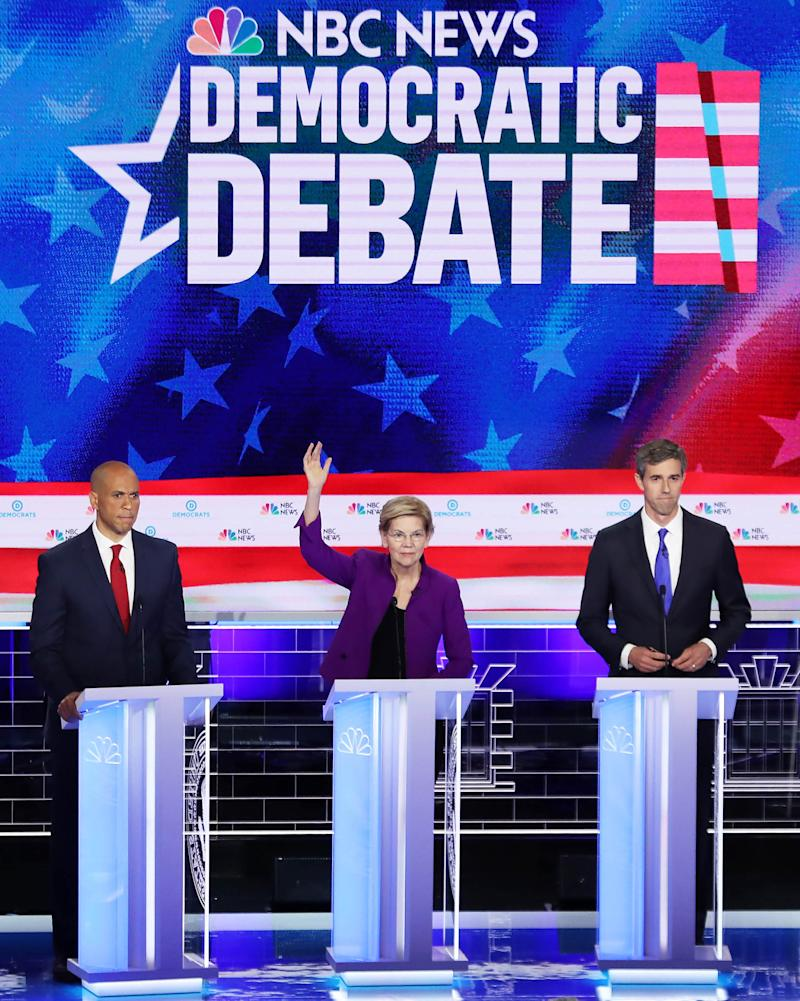 (L-R) Sen. Cory Booker (D-NJ), Sen. Elizabeth Warren (D-MA) and former Texas congressman Beto O'Rourke take part in the first night of the Democratic presidential debate on June 26, 2019 in Miami, Florida. | Joe Raedle—Getty Images