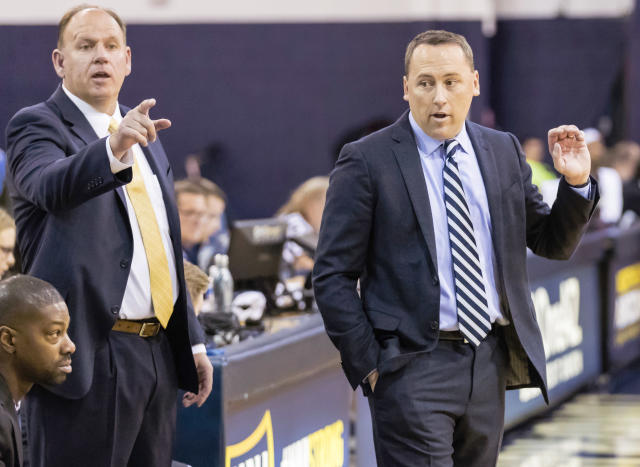 This photo provided by Northern Arizona Athletics shows Shane Burcar, left, who has taken over as Northern Arizonas head basketball coach after Jack Murphy, right, left to become the associate head coach at Arizona. Burcar was a career high school coach before joining Murphys staff in 2018 and was named interim coach after Murphy left in June. (Northern Arizona Athletics via AP)
