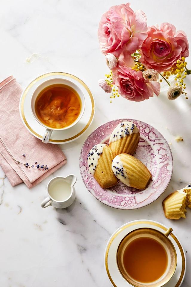 """<p>Pair this floral-infused dessert with a cup of hot tea for a calming post-dinner treat. </p><p><a class=""""body-btn-link"""" href=""""https://www.amazon.com/dp/B07HJ2JP65/ref=dp_cerb_1?tag=syn-yahoo-20&ascsubtag=%5Bartid%7C10055.g.19692275%5Bsrc%7Cyahoo-us"""" target=""""_blank"""">SHOP MADELEINE MOLD</a></p><p><em><a href=""""https://www.goodhousekeeping.com/food-recipes/dessert/a27274891/white-chocolate-and-lavender-madeleines-recipe/"""" target=""""_blank"""">Get the recipe for White Chocolate and Lavender Madeleines »</a></em> </p><p><strong>RELATED:</strong> <a href=""""https://www.goodhousekeeping.com/holidays/mothers-day/g4249/mothers-day-desserts/"""" target=""""_blank"""">40 Sweet Mother's Day Desserts That Double as Gifts</a></p>"""