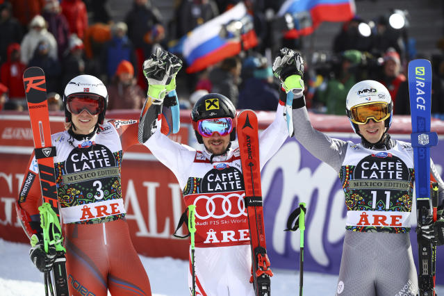 Austria's Marcel Hirscher, center, the winner, poses with runner-up Norway's Henrik Kristoffersen, and third placed France's Victor Muffat-Jeandet in the finish area after completing a men's giant slalom at the alpine ski World Cup finals in Are, Sweden, Saturday, March 17, 2018. (AP Photo/Marco Trovati)
