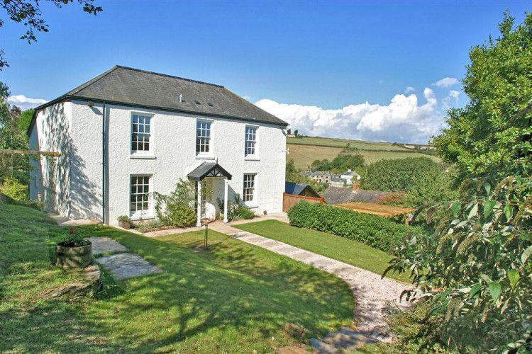 """<p>Country living doesn't get much better than this charming white-stone house in Salcombe, South Devon. Step inside and you'll fall in love with the traditional features, spacious living areas, wooden beams and cosy furnishings. </p><p><strong>Guests: </strong>Up to 10<br><strong>Pricing: </strong>From £1,572</p><p><a class=""""link rapid-noclick-resp"""" href=""""https://go.redirectingat.com?id=127X1599956&url=https%3A%2F%2Fwww.toadhallcottages.co.uk%2Fholiday-cottages%2Fperrotts%2F767&sref=https%3A%2F%2Fwww.countryliving.com%2Fuk%2Ftravel-ideas%2Fstaycation-uk%2Fg35804522%2Fgroup-accommodation-holiday-homes-uk%2F"""" rel=""""nofollow noopener"""" target=""""_blank"""" data-ylk=""""slk:BOOK NOW"""">BOOK NOW</a> </p>"""