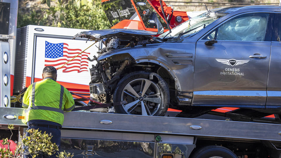 Tiger Woods' car, pictured here being removed from the crash site.