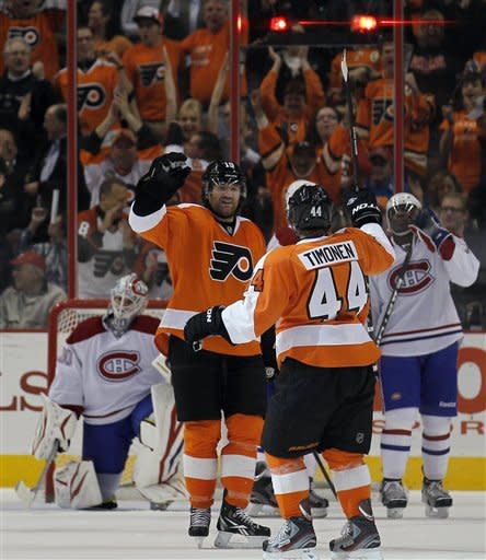 Philadelphia Flyers defenseman Kimmo Timonen (44), from Finland, reacts with teammate Scott Hartnell (19) after scoring a goal in the first period of an NHL hockey game with the Montreal Canadiens, Saturday, March 24, 2012, in Philadelphia. (AP Photo/Alex Brandon)