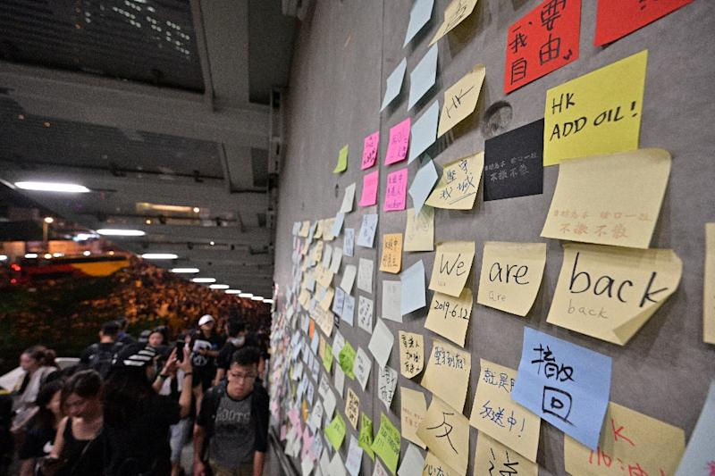 "Messages left by protesters are posted on what they call ""the Lennon Wall"" (AFP Photo/Anthony WALLACE)"