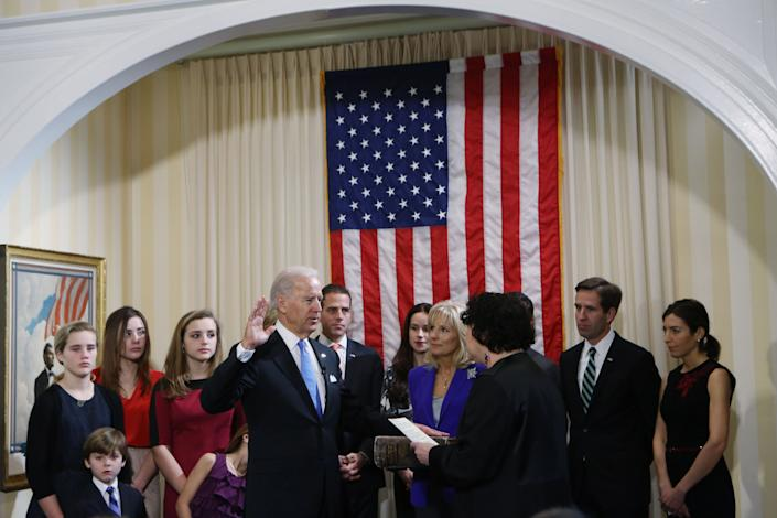 Biden takes the oath of office from Supreme Court Justice Sonia Sotomayor as his family looks on during the official swearing-in ceremony at the Naval Observatory on January 20, 2013, a day before the inauguration.