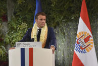 France's President Emmanuel Macron France's President wearing a flower lei and seashell necklaces delivers a speech after a meeting with the President of the French Polynesia Edouard Fitch in Tahiti, French Polynesia in the Pacific Ocean, Tuesday, 27, 2021.President Emmanuel Macron reasserted France's presence in the Pacific on a visit to French Polynesia aimed in part at countering growing Chinese dominance in the region. (AP Photo/Esther Cuneo)