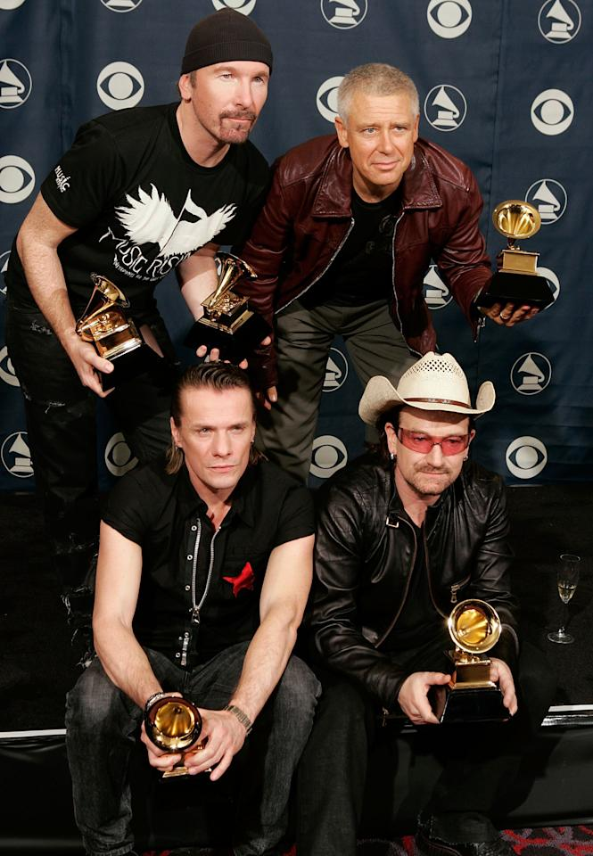 Musicians Larry Mullens Jr., the Edge, Adam Clayton and Bono pose with their Album of the Year award in the press room at the 48th Annual Grammy Awards at the Staples Center on February 8, 2006 in Los Angeles, California.  (Photo by Kevin Winter/Getty Images)