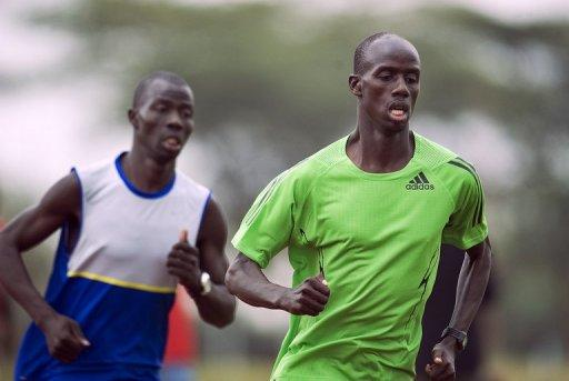 Brimin Kipruto (right) goes through the paces 2012 with compatriot African champion Abel Mutai