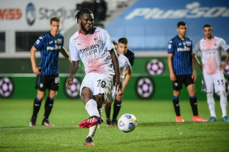 Ivorian Franck Kessie (C) converts a second penalty for AC Milan in a 2-0 win over Atalanta.