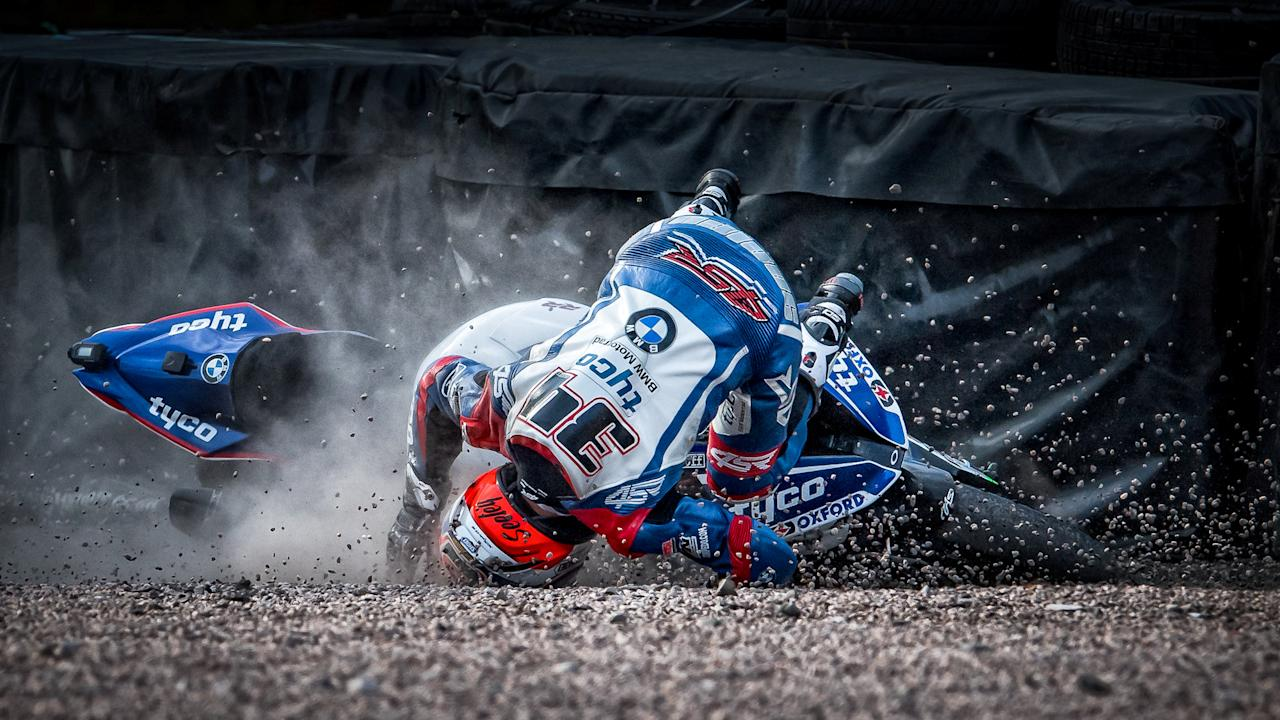 <p>Terry Donnelly from Liverpool came second for this dramatic shot of a motorbike crash.<br />Taken during a race in Cheshire, Donnelly said: 'The motorcycle shot was from Oulton Park, when a rider had lost control of the motorbike and slid into the run off area and become detached from the motorbike.<br />'The rider was unhurt and quickly stood up and walk away, which is a testament to the safety of UK race circuits and their designs.' (SWNS) </p>