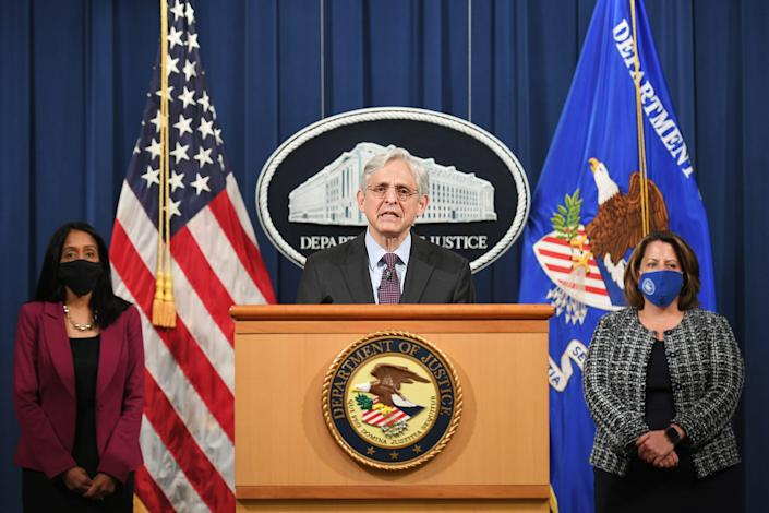 Attorney General Merrick Garland, flanked by Associate Attorney General Vanita Gupta, left, and Deputy Attorney General Lisa Monaco, announces April 26 that the Justice Department will investigate the practices of the Louisville Metro Police Department in Kentucky. A report of any constitutional and unlawful violations will be published.