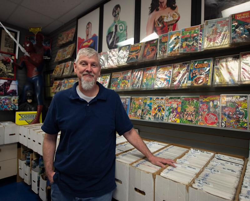 """Ned Senft, co-owner of Comix Collection in York. Senft has noticed an increase in customers ever since superhero movies have become a mainstay in pop culture over a decade ago. However, he doesn't expect a surge in sales with the release of """"Avengers: Endgame"""" this weekend."""