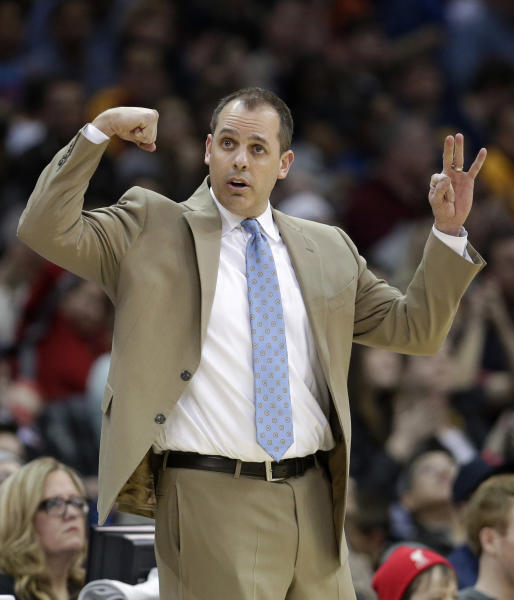Indiana Pacers head coach Frank Vogel makes a sign for his team during the third quarter of an NBA basketball game against the Cleveland Cavaliers Sunday, March 30, 2014, in Cleveland. Cleveland defeated Indiana 90-76. (AP Photo/Tony Dejak)