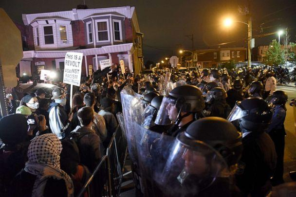 PHOTO: Protesters face off with police during a demonstration Tuesday, Oct. 27, 2020, in Philadelphia. Hundreds of demonstrators marched in West Philadelphia over the death of Walter Wallace Jr., a Black man who was killed by police on Monday.  (Michael Perez/AP)
