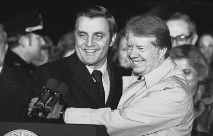 FILE - President Jimmy Carter embraces Vice President Walter Mondale on the South Lawn of the White House in Washington on Jan. 7, 1978, after Carter returned from a nine-day overseas trip. A new CNN Films documentary explores the role of the U.S. vice presidency, which in modern times has emerged into a more powerful position. Still, the film notes that a veep's duties are all up to the president. (AP Photo/John Duricka, File)