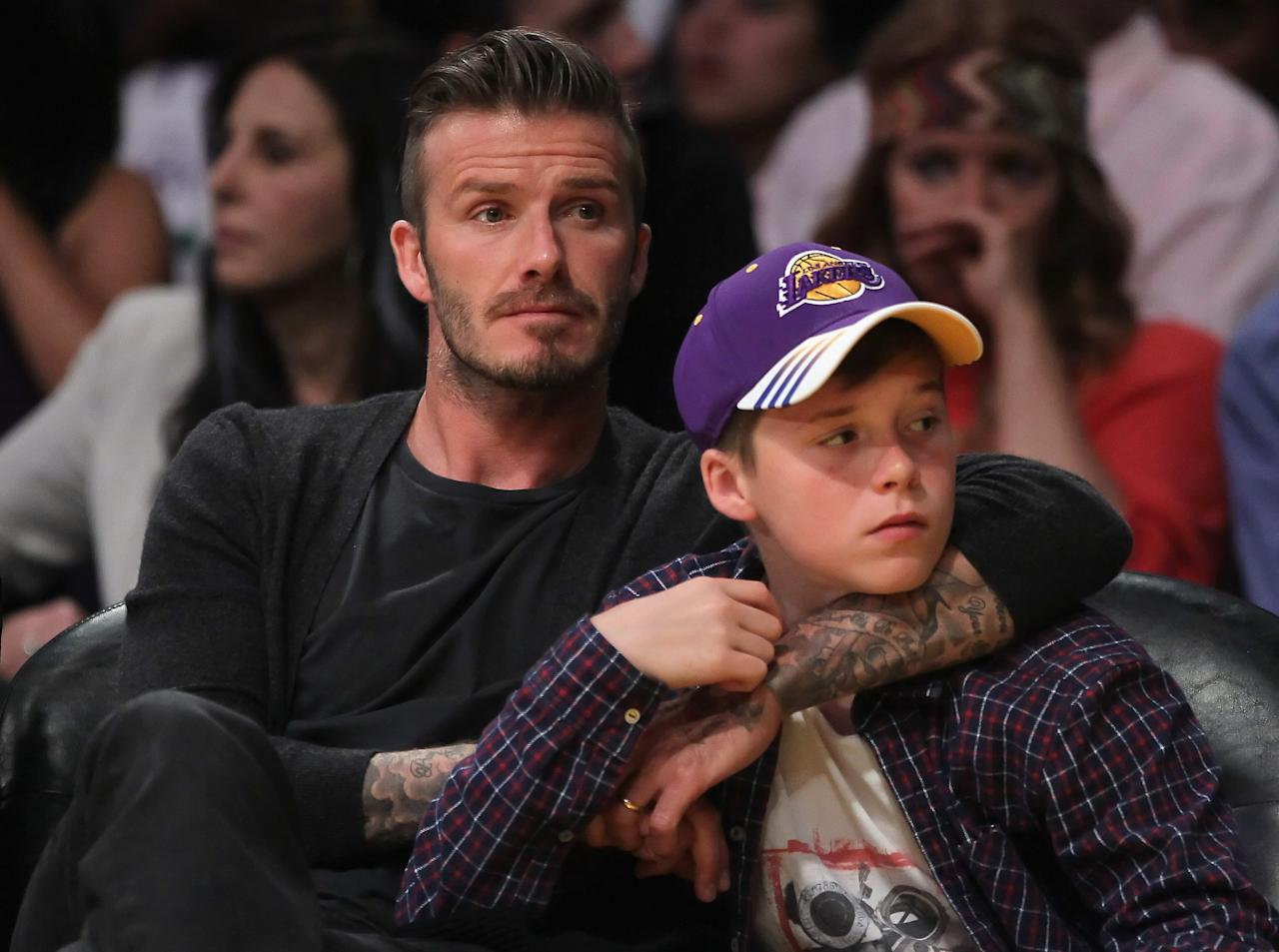 LOS ANGELES, CA - APRIL 29:  David Beckham and son Brooklyn take in Game One of the Western Conference Quarterfinals between the Los Angeles Lakers and the Denver Nuggets in the 2012 NBA Playoffs on April 29, 2012 at Staples Center in Los Angeles, California. The Lakers defeated the Nuggets 103-88. NOTE TO USER: User expressly acknowledges and agrees that, by downloading and or using this photograph, User is consenting to the terms and conditions of the Getty Images License Agreement.  (Photo by Jeff Gross/Getty Images)