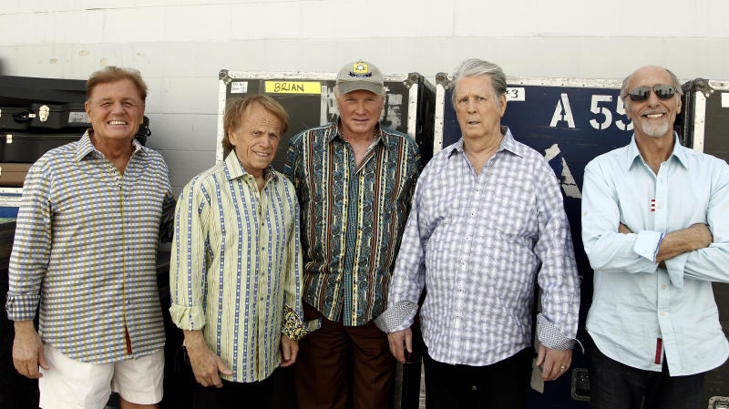 In this April 18, 2012 photo, The Beach Boys, from left, Bruce Johnston, Al Jardine, Mike Love, Brian Wilson and David Marks pose for a portrait in Burbank, Calif. After decades of prolonged separations, legal spats and near reunions, the core Beach Boys are back together, both on stage and for an upcoming new album. (AP Photo/Matt Sayles)