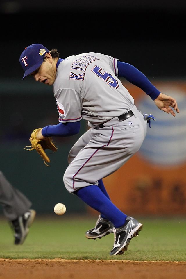 ST LOUIS, MO - OCTOBER 20: Ian Kinsler #5 of the Texas Rangers makes an error on a ball hit by Lance Berkman #12 of the St. Louis Cardinals in the fourth inning during Game Two of the MLB World Series at Busch Stadium on October 20, 2011 in St Louis, Missouri.  (Photo by Ezra Shaw/Getty Images)