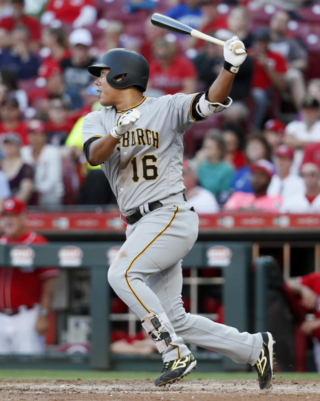FILE - In this Sept. 29, 2018, file photo, Pittsburgh Pirates' Jung Ho Kang hits a single off Cincinnati Reds starting pitcher Michael Lorenzen in the sixth inning of a baseball game in Cincinnati. The return of third baseman Jung Ho Kang, who hit 36 homers in 2015 and 2016 before his career was derailed after being arrested on a DUI charge in his native South Korea in late 2016, should help the Pirates this season. (AP Photo/John Minchillo, File)