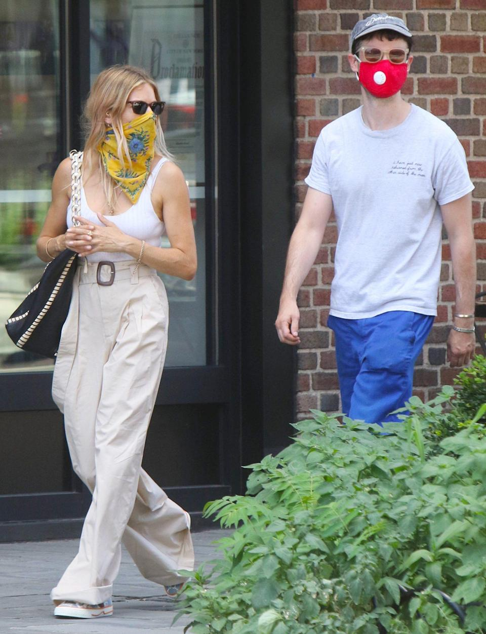 <p>Sienna Miller and Tom Sturridge mask up for a stroll around N.Y.C. on Tuesday.</p>
