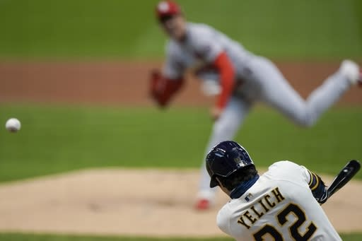 Milwaukee Brewers' Christian Yelich hits a double off St. Louis Cardinals starting pitcher Kwang Hyun Kim during the first inning of the first game of a baseball doubleheader Monday, Sept. 14, 2020, in Milwaukee. (AP Photo/Morry Gash)
