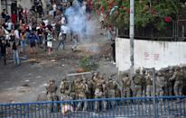 Lebanese soldiers fire rubber bullets during sporadic clashes with supporters of Lebanon's prime minister-designate Saad Hariri, who stepped down saying he was unable to form a government, in the capital Beirut on Thursday