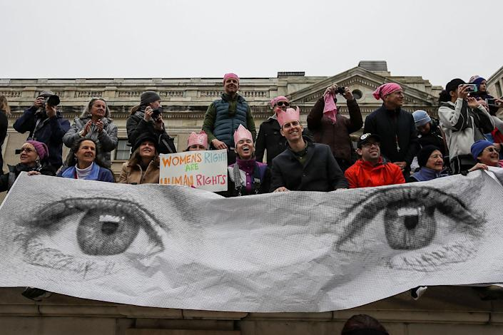 <p>Protesters cheer on the side of Independence Avenue during the Women's March on Washington January 21, 2017 in Washington, DC. (Drew Angerer/Getty Images) </p>