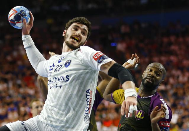 Handball - Men's EHF Champions League Final - HBC Nantes vs Montpellier HB - Lanxess Arena, Cologne, Germany - May 27, 2018. Ludovic Fabregas of Montpellier HB in action with Rock Feliho of HBC Nantes. REUTERS/Thilo Schmuelgen