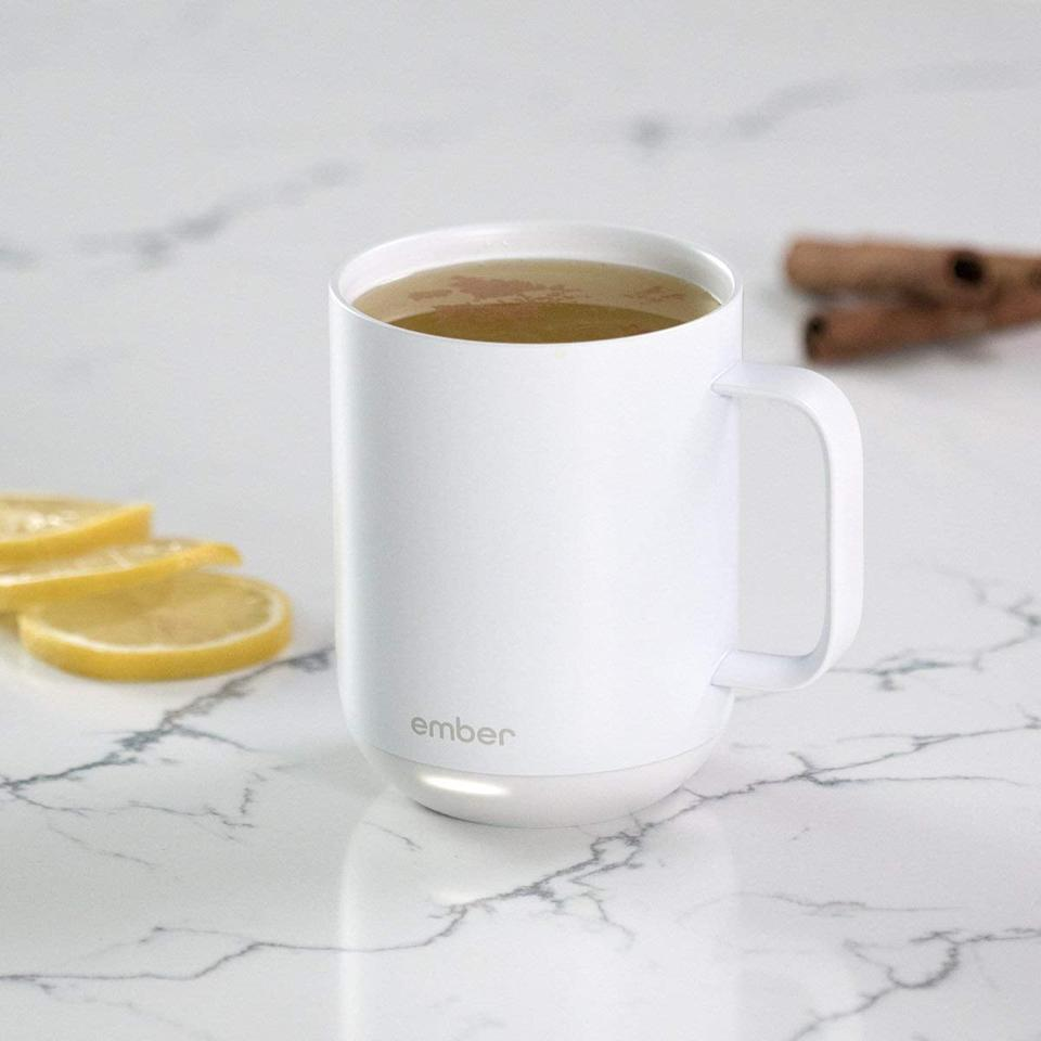 """<p>This <a href=""""https://www.popsugar.com/buy/Ember-Temperature-Control-Ceramic-Mug-530463?p_name=Ember%20Temperature%20Control%20Ceramic%20Mug&retailer=amazon.com&pid=530463&price=80&evar1=fit%3Aus&evar9=45236734&evar98=https%3A%2F%2Fwww.popsugar.com%2Ffitness%2Fphoto-gallery%2F45236734%2Fimage%2F47090539%2FEmber-Temperature-Control-Ceramic-Mug&list1=shopping%2Chealthy%20living%20tips%2Cmornings%2Cmorning%20routines&prop13=mobile&pdata=1"""" rel=""""nofollow"""" data-shoppable-link=""""1"""" target=""""_blank"""" class=""""ga-track"""" data-ga-category=""""Related"""" data-ga-label=""""https://www.amazon.com/dp/B07NQPYGYD/ref=twister_B0821YFT64?_encoding=UTF8&amp;psc=1"""" data-ga-action=""""In-Line Links"""">Ember Temperature Control Ceramic Mug</a> ($80) will keep your drink at your desired temperature for however long you decide to nurse it, which, in the mornings, is kind of a game changer.</p>"""