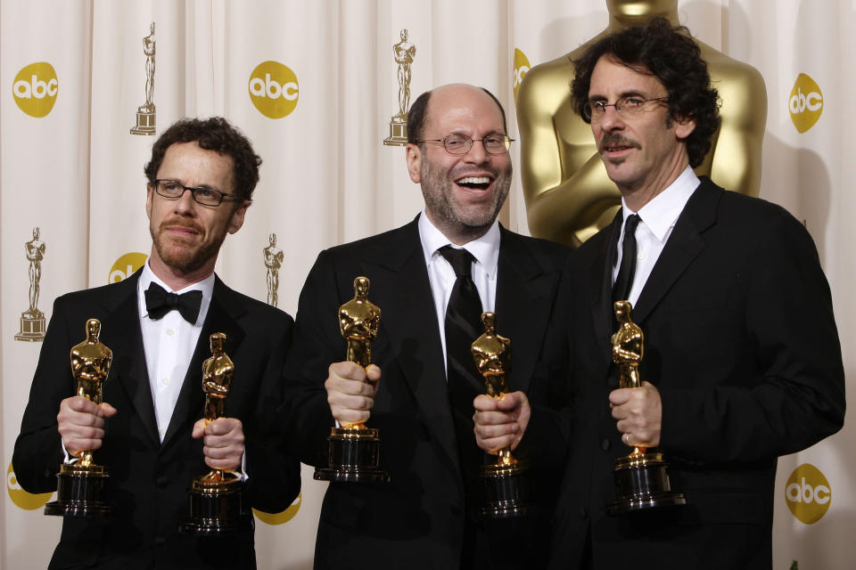 "FILE - Writer-director Ethan Coen, from left, producer Scott Rudin and writer-director Joel Coen pose with their Oscars after the film ""No Country for Old Men"" won best motion picture of the year at the 80th Academy Awards in Los Angeles on Feb. 24, 2008. Rudin, one of the most successful and powerful producers, with a heap of Oscars and Tonys to show for it, has long been known for his torturous treatment of an ever-churning parade of assistants. Such behavior has long been engrained — and sometimes even celebrated — in show business. (AP Photo/Kevork Djansezian, File)"