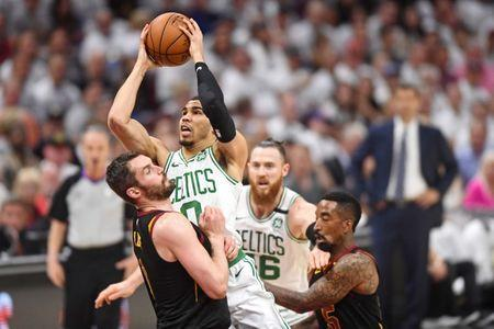 May 25, 2018; Cleveland, OH, USA; Boston Celtics forward Jayson Tatum (0) shoots the ball against Cleveland Cavaliers center Kevin Love (0) during the first quarter in game six of the Eastern conference finals of the 2018 NBA Playoffs at Quicken Loans Arena. Mandatory Credit: Ken Blaze-USA TODAY Sports