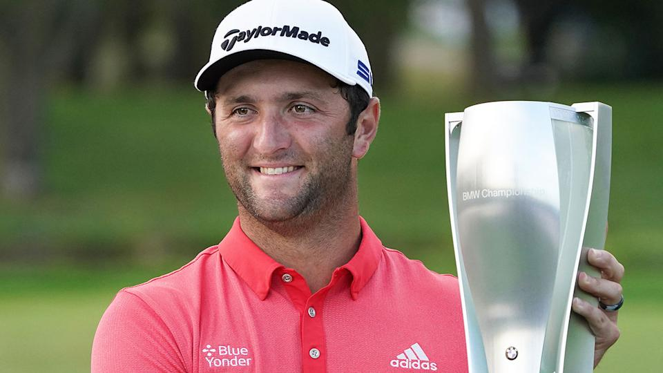 Seen here, Jon Rahm poses with the BMW Championship trophy.