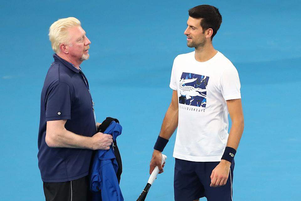 Boris Becker (pictured left) and Novak Djokovic (pictured right) talk during training.