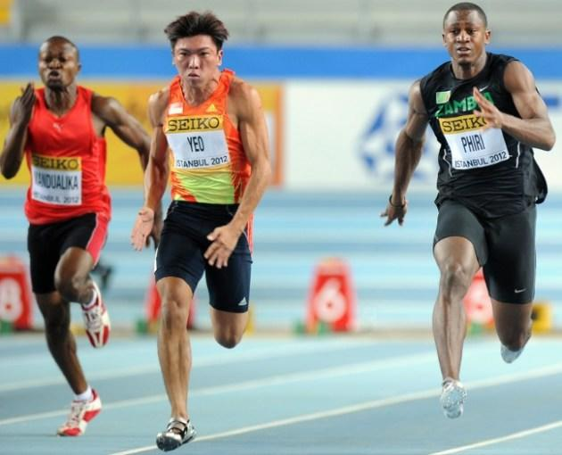 Democratic Republic of Congo's Ghislain Nsimba Mandualika (L), Singapore's Gary Yeo Foo Ee (C) and Zambia's Gerald Phiri (R) compete during the men's 60m qualifications at the 2012 IAAF World Indoor Athletics Championships at the Atakoy Athletics Arena in Istanbul on March 9, 2012. AFP PHOTO / ADRIAN DENNIS