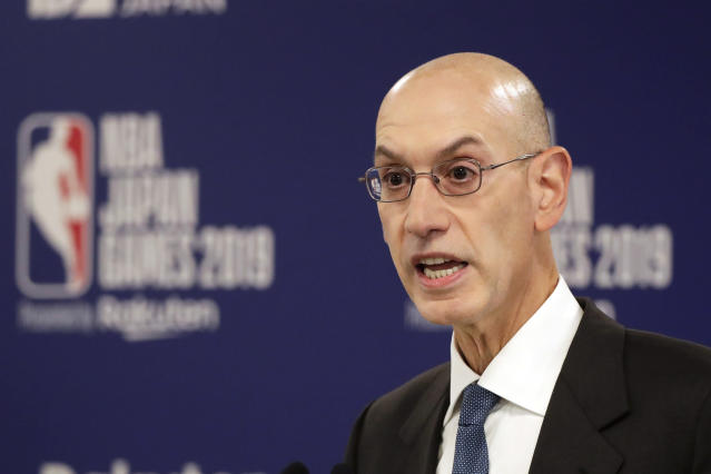 FILE - In this Oct. 8, 2019, file photo, NBA Commissioner Adam Silver speaks at a news conference before an NBA preseason basketball game between the Houston Rockets and the Toronto Raptors in Saitama, Japan. A person familiar with the negotiations says the NBA is working with the players union and its teams on a plan to shorten the regular season, possibly to 78 games. (AP Photo/Jae C. Hong, File)