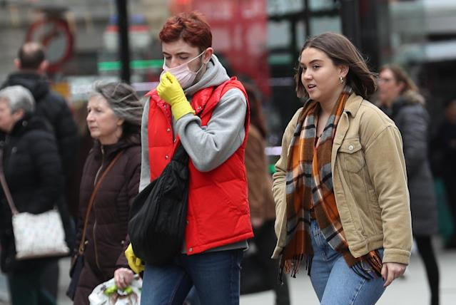 A man wearing a protective face mask in Oxford Street, London. (Yui Mok/PA Images via Getty Images)