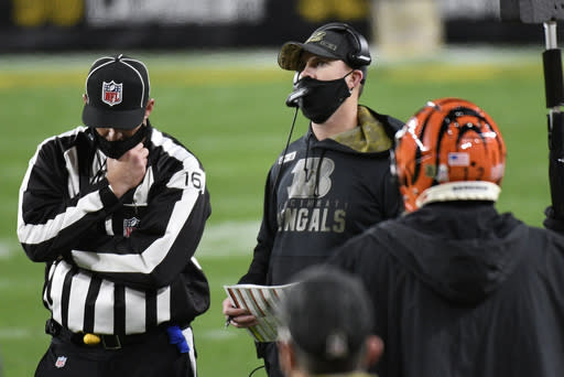 Cincinnati Bengals head coach Zac Taylor, center, looks at the scoreboard during the second half of an NFL football game against the Pittsburgh Steelers in Pittsburgh, Sunday, Nov. 15, 2020. (AP Photo/Don Wright)