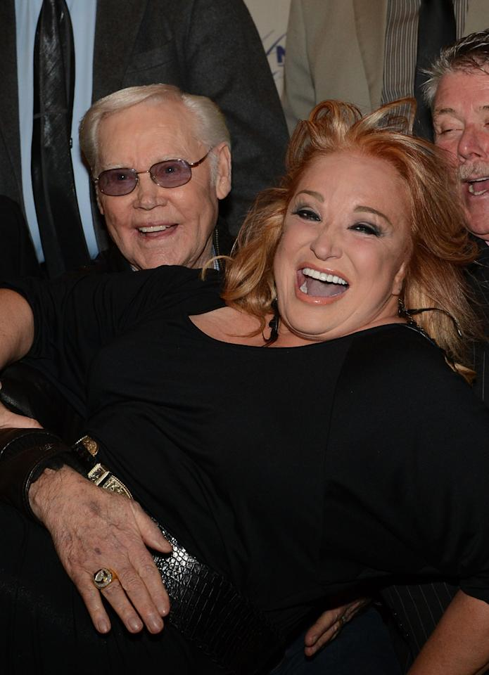 NASHVILLE, TN - NOVEMBER 14:  Singer/Songwriter George Jones and Recording Artist Tanya Tucker during the 2012 NATD Honors at The Hermitage Hotel on November 14, 2012 in Nashville, Tennessee.  (Photo by Rick Diamond/Getty Images for Nashville Association of Talent Directors)