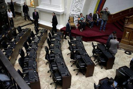 A general view of Venezuela's National Assembly shows empty chairs of deputies of Venezuela's United Socialist Party (PSUV) during a session in Caracas