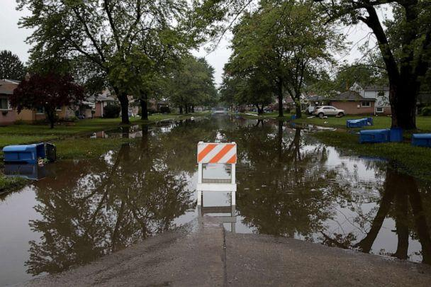 PHOTO: A road marker is seen blocking off Hanover Street which flooded as a result of heavy rain in Dearborn Heights, Michigan, July 17, 2021. (Emily Elconin/Reuters)