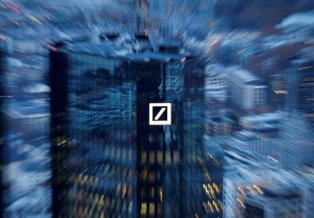 FILE PHOTO: The financial district with the headquarters of Germany's largest business bank, Deutsche Bank , is photographed on early evening in Frankfurt