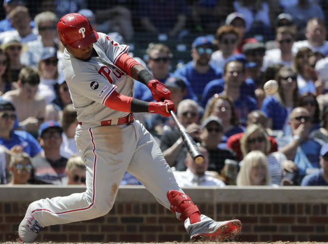 Philadelphia Phillies' Jean Segura hits a two-run home run against the Chicago Cubs during the fourth inning of a baseball game Thursday, May 23, 2019, in Chicago. (AP Photo/Nam Y. Huh)
